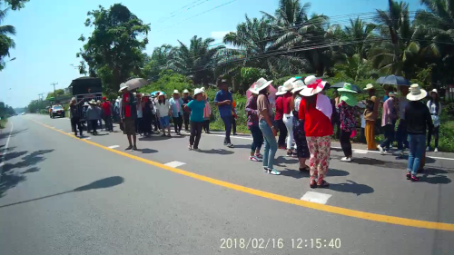 Group of people dancing on the road (??)